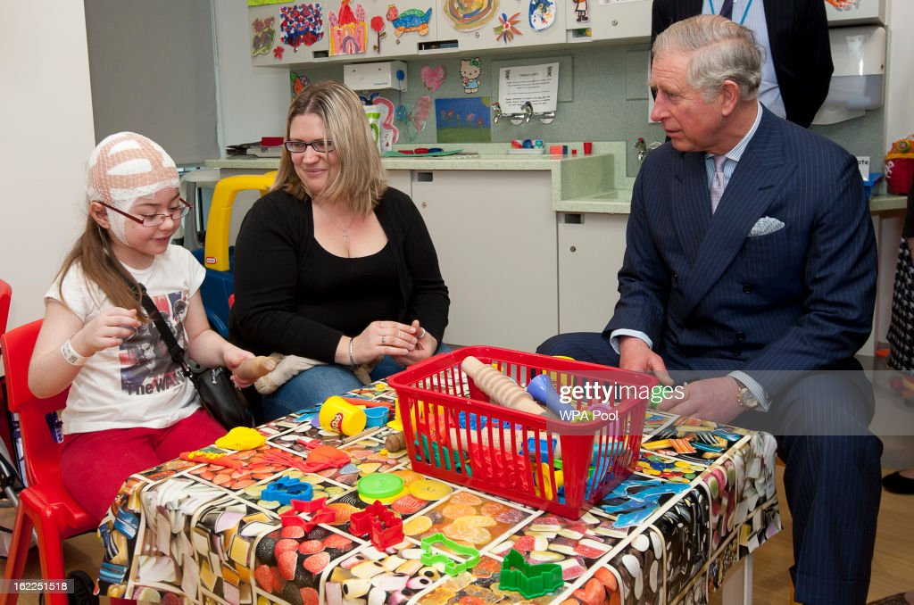 Prince Charles, Prince of Wales meets with staff and patients including Katie Tuffin, 8, and her mother Emma from Cambridgeshire at Great Ormond Street Children's hospital on February 21, 2013 in London, England.