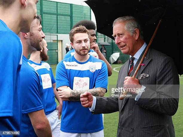 Prince Charles Prince of Wales meets young offenders taking part in a 'Get Started with Football' programme run by the Prince's Trust during a visit...