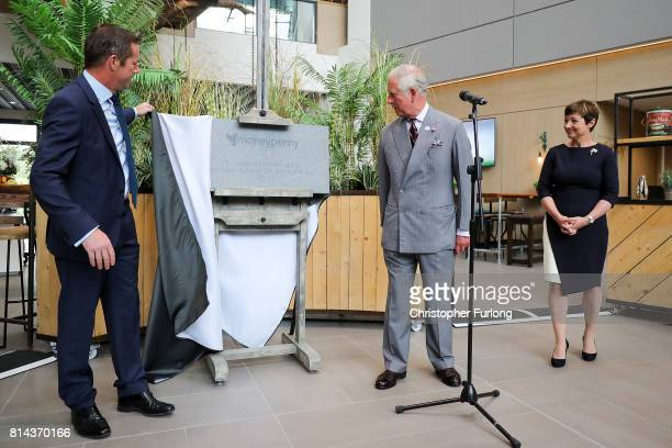Prince Charles Prince of Wales officially opens the headquarters of Moneypenny Ltd with cofounders Ed Reeves and Rachel Clacher during his annual...