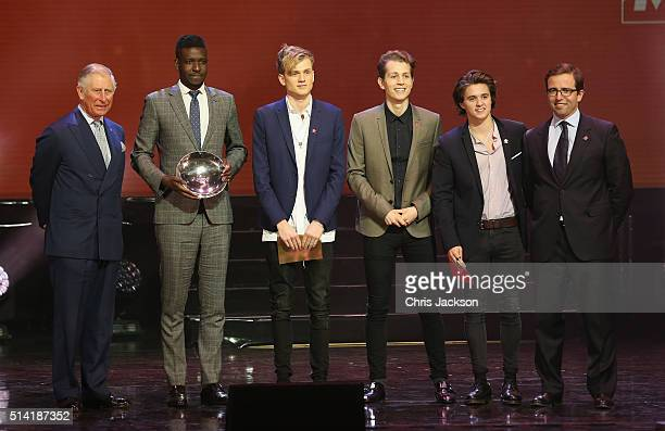Prince Charles Prince of Wales on stage with Enterprise Award Winner Francis Ondoro and the 'Vamps' during the Prince's Trust Celebrate Success...