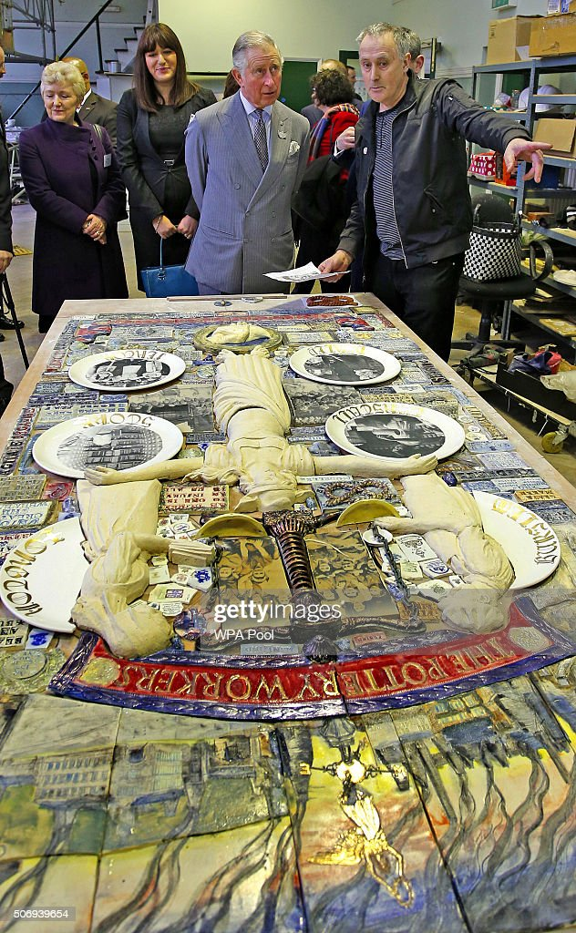Prince Charles Prince of Wales Patron and Founder of the Prince's Regeneration Trust and artist Philip Hardaker look at artwork by children during...