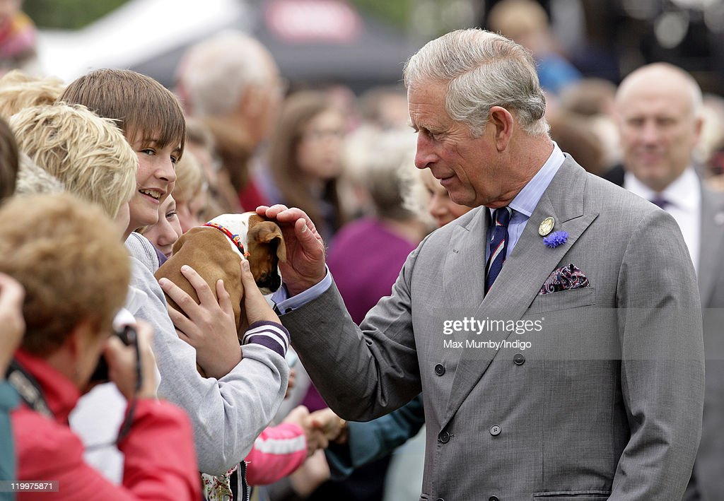 <a gi-track='captionPersonalityLinkClicked' href=/galleries/search?phrase=Prince+Charles+-+Prince+of+Wales&family=editorial&specificpeople=160180 ng-click='$event.stopPropagation()'>Prince Charles</a>, Prince of Wales pats a puppy during a walkabout as he visits the 130th Sandringham Flower Show on July 27, 2011 in Huntingdon, England.