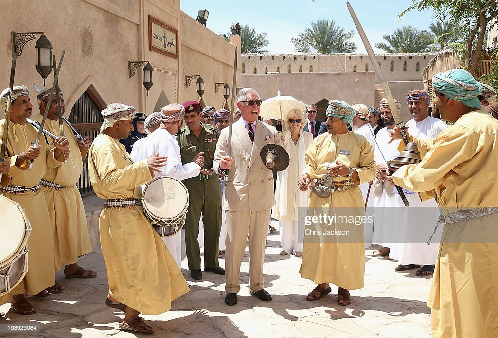 <a gi-track='captionPersonalityLinkClicked' href=/galleries/search?phrase=Prince+Charles&family=editorial&specificpeople=160180 ng-click='$event.stopPropagation()'>Prince Charles</a>, Prince of Wales (C) performs a traditional sword dance with local Omanis as he visits Nizwa Fort on the eighth day of a tour of the Middle East on March 18, 2013 in Nizwa, Oman. The Royal couple are on the fourth and final leg of a tour of the Middle East taking in Jordan, Qatar, Saudia Arabia and Oman.