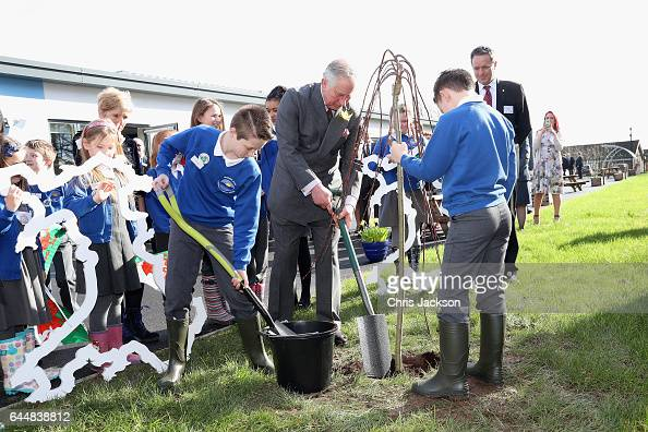 Prince Charles Prince of Wales plants a tree with pupils and teachers involved in a climate change education programme run by the charity Size of...