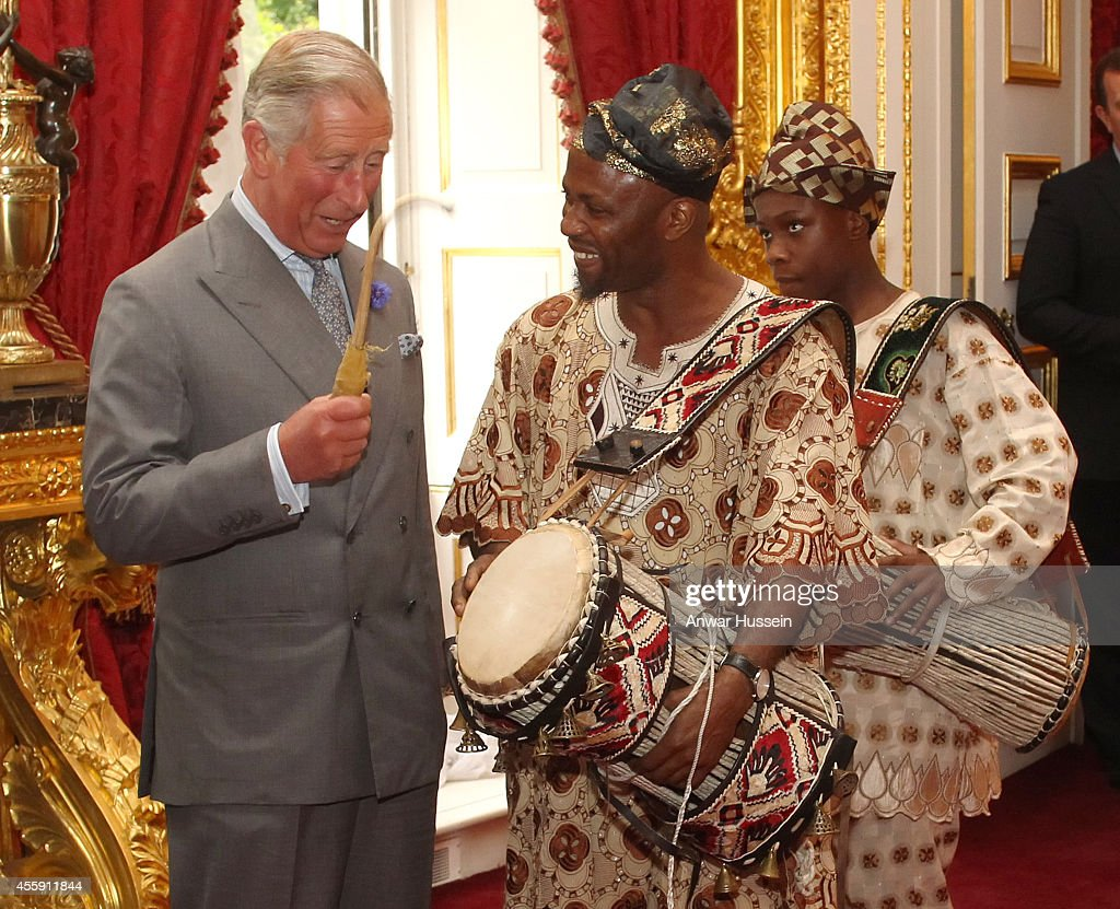 <a gi-track='captionPersonalityLinkClicked' href=/galleries/search?phrase=Prince+Charles&family=editorial&specificpeople=160180 ng-click='$event.stopPropagation()'>Prince Charles</a>, Prince of Wales plays a drum held by musician Ayan De First of Oduduwa Talking Drummers at a reception for members of Britain's West African origin community at Clarence House on July 20, 2011 in London, England.