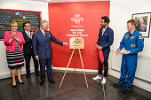 Prince Charles Prince of Wales points to a plaque as it is unveilled during a visit to his Prince's Trust centre where the charity's beneficiaries...