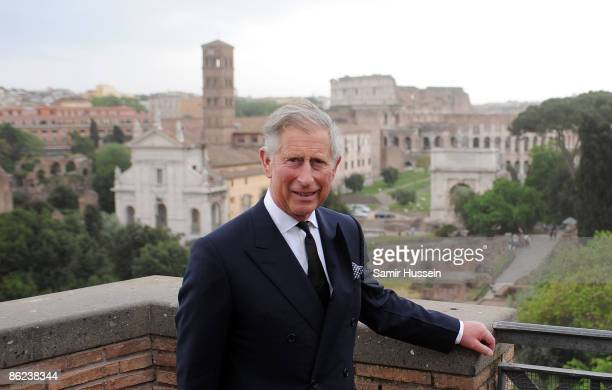 Prince Charles Prince of Wales poses as looks at the view of the Colosseum during a visit to the House of Augustus on day one of his tour of Italy...