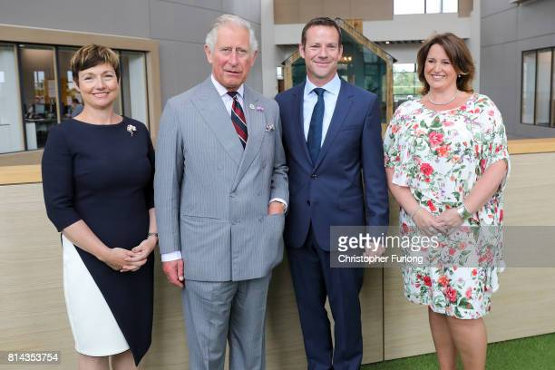 Prince Charles Prince of Wales poses for a photograph with Moneypenny cofounders Ed Reeves and Rachel Clacher and company director Joanna Swash...