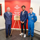 Prince Charles Prince of Wales poses with Daniel Edmund who is a young ambassador and British astronaught Tim Peake during a visit to his his...
