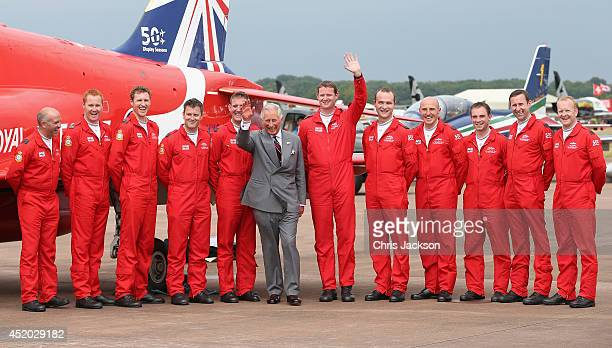 Prince Charles Prince of Wales poses with RAF Red Arrows pilots during a visit to the Royal International Air Tattoo at RAF Fairford on July 11 2014...