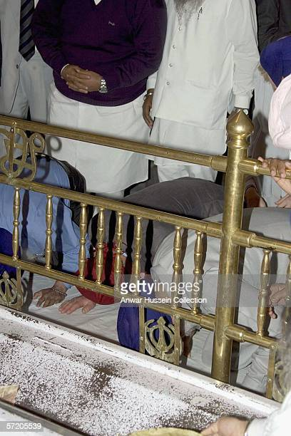 Prince Charles Prince of Wales prays as he visits the Anadpur Sahib Gurdwara on the eighth day of a 12 day official tour visiting Egypt Saudi Arabia...