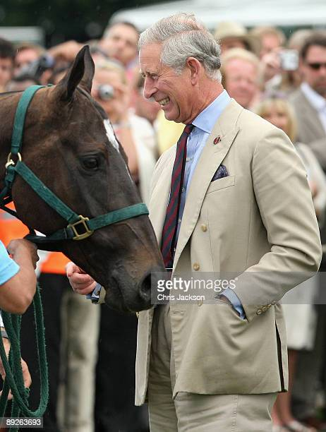 Prince Charles Prince of Wales prepares to present the Coronation Cup to the Captain of the Argentinian Team Adolfo Cambiaso after they beat England...