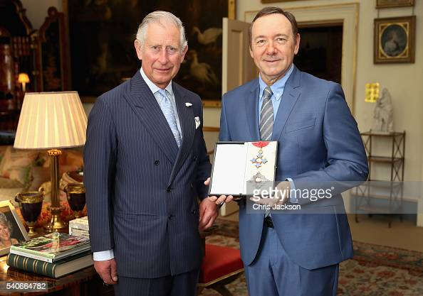 Prince Charles Prince of Wales presents actor Kevin Spacey with his honorary KBE for services to the theatre arts education and international culture...