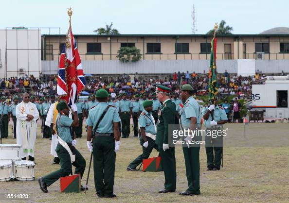 Prince Charles Prince of Wales presents new colours to the Royal Pacific Island Regiment in Sir John Guise Stadium during a cultural event on...