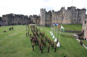 Prince Charles Prince of Wales presents the Queen's Own Yeomanry with its first Guidon a consecrated flag at Alnwick Castle on 22 September 2007 in...