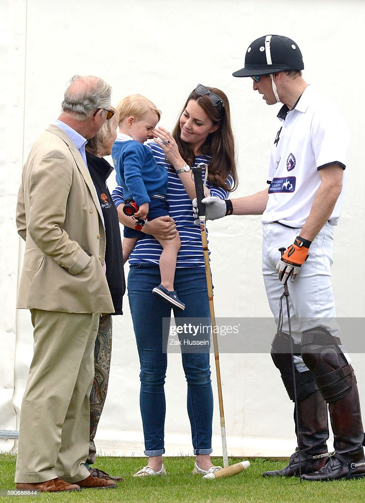 Prince Charles Prince of Wales Prince George Catherine Duchess of Cambridge and Prince William Duke of Cambridge attend the Gigaset Charity Polo...