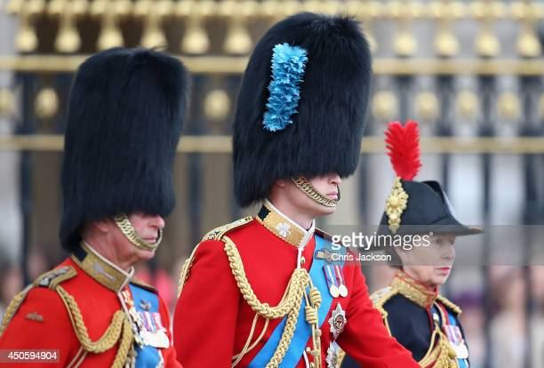 Prince Charles Prince of Wales Prince William Duke of Cambridge and Princess Anne Princess Royal travel by horse during Trooping the Colour Queen...