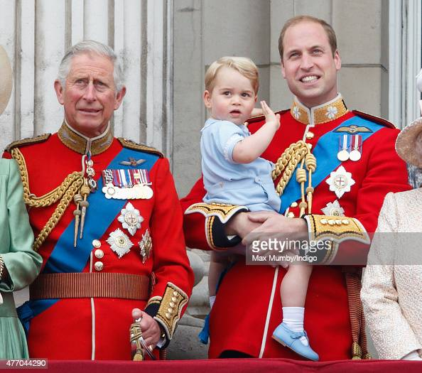 Prince Charles Prince of Wales Prince William Duke of Cambridge and Prince George of Cambridge stand on the balcony of Buckingham Palace during...