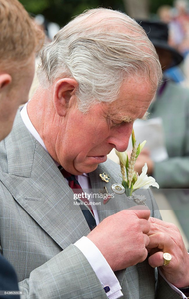 <a gi-track='captionPersonalityLinkClicked' href=/galleries/search?phrase=Prince+Charles+-+Prince+of+Wales&family=editorial&specificpeople=160180 ng-click='$event.stopPropagation()'>Prince Charles</a>, Prince of Wales puts on his butonhole during a visit to The Royal Norfolk Show at Norfolk Showground on June 29, 2016 in Norwich, England.