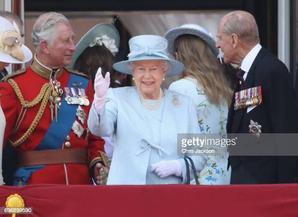 Prince Charles Prince of Wales Queen Elizabeth II and Prince Philip Duke of Edinburgh look out from the balcony of Buckingham Palace during the...