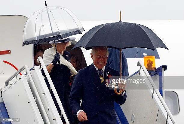 Prince Charles Prince of Wales reacts as he disembarks a plane with Camilla Duchess of Cornwall after arriving in Canberra on November 11 2015 in...