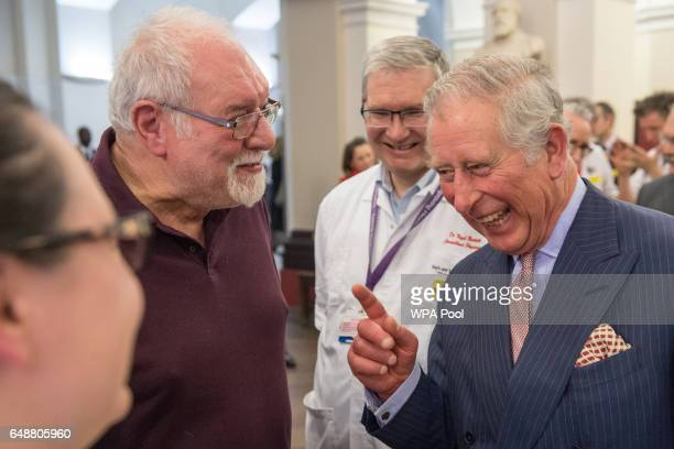 Prince Charles Prince of Wales reacts as he talks with patient Leon Kreitzman and healthcare professionals during his visit to St Thomas's Hospital...