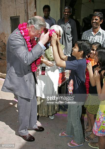Prince Charles Prince of Wales receives a garland as he takes a walking tour of the Old City on the final day of a 12 day official tour visiting...