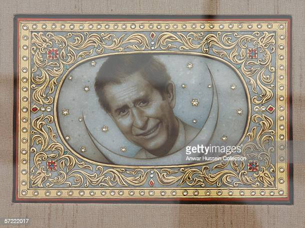 Prince Charles Prince of Wales receives a picture of himself as he takes a walking tour of the Old City on the final day of a 12 day official tour...