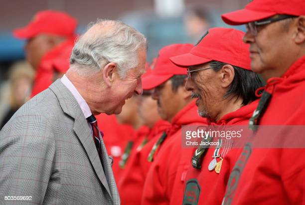 Prince Charles Prince of Wales reviews Canadian Rangers during an official welcome ceremony at Nunavut Legislative Assembley during a 3 day official...