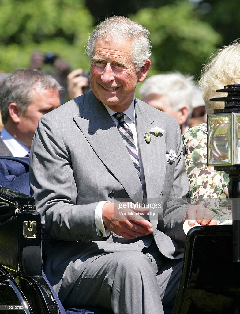 Prince Charles, Prince of Wales rides in a horse drawn carriage as he tours the Sandringham Flower Show along with Camilla, Duchess of Cornwall at Sandringham on July 25, 2012 in King's Lynn, England.