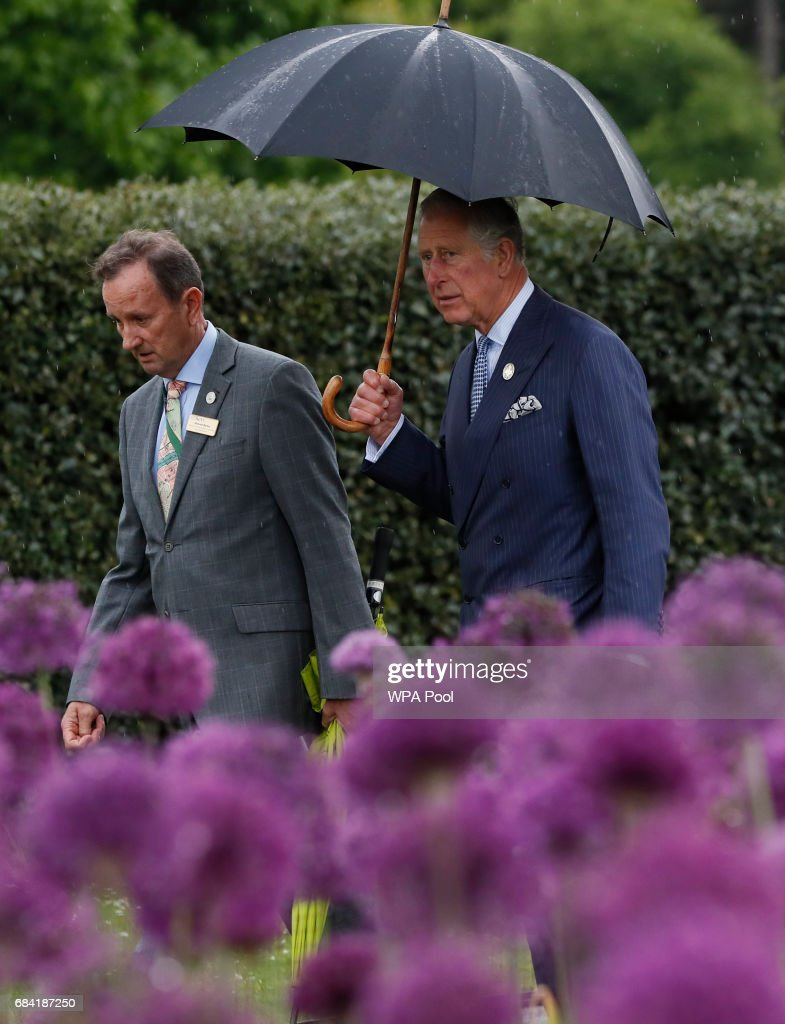 Prince Charles, Prince of Wales, right, walks past a display of alliums tours the Great Broad Walk during a visit to the Royal Botanic Gardens on May 17, 2017 in London, England. Prince Charles, Prince of Wales attended the launch of the annual State of the World's Plants report and viewed the Great Broad Walk Borders at the Royal Botanic Gardens, Kew.