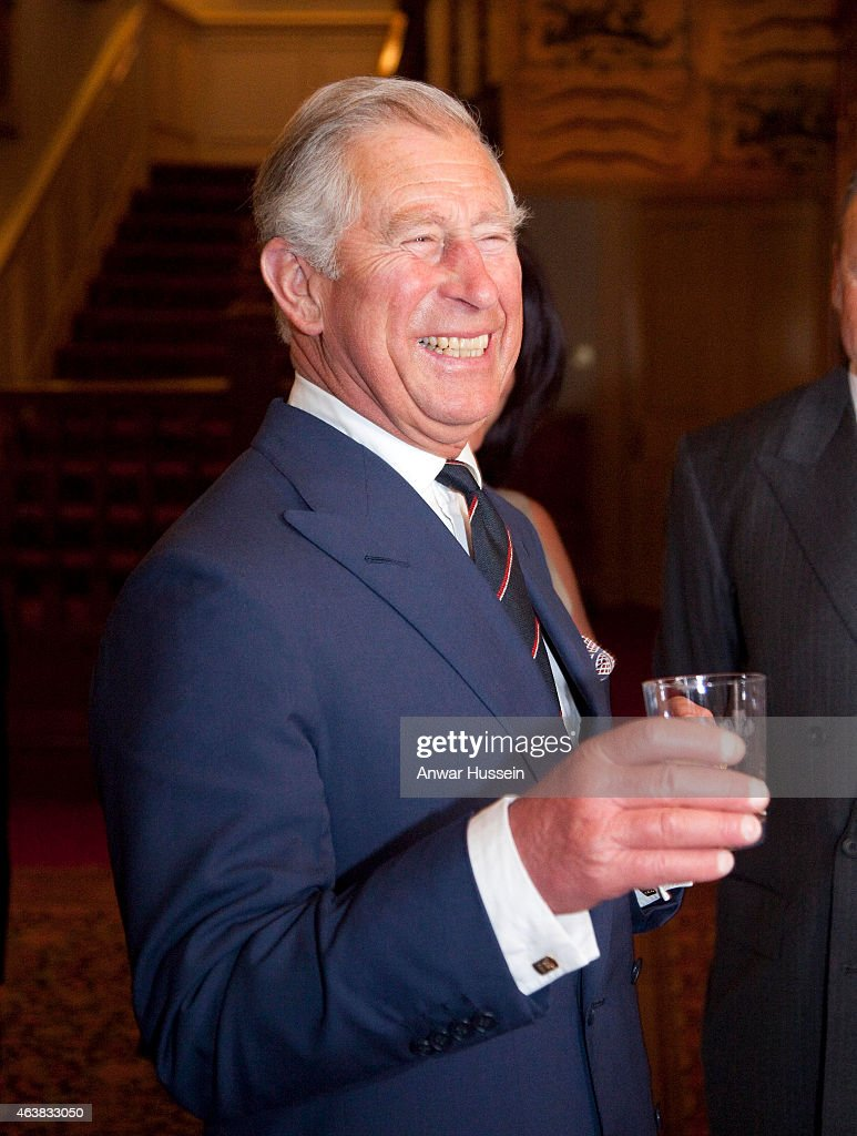 <a gi-track='captionPersonalityLinkClicked' href=/galleries/search?phrase=Prince+Charles+-+Prince+of+Wales&family=editorial&specificpeople=160180 ng-click='$event.stopPropagation()'>Prince Charles</a>, Prince of Wales samples a drink as he hosts a reception for supporters , Trustees and Scholars for the Queen Elizabeth Scholarship Trust at Clarence House on May 30, 2012 in London, England.