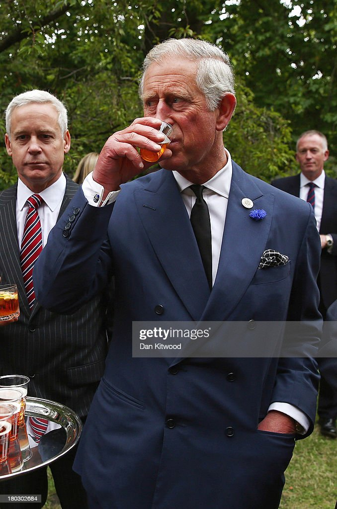 <a gi-track='captionPersonalityLinkClicked' href=/galleries/search?phrase=Prince+Charles&family=editorial&specificpeople=160180 ng-click='$event.stopPropagation()'>Prince Charles</a>, Prince of Wales samples beer during a reception to celebrate the 21st anniversary of Duchy originals products at Clarence House on September 11, 2013 in London, England. The reception was held in the gardens of Clarence House, and attended by Duchy suppliers, Waitrose and other international stockists, customers, charitable beneficiaries and representatives of some of the charities who benefit from the sale of the products.