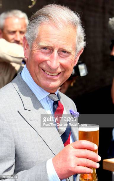 Prince Charles Prince of Wales samples carbon neutral beer outside The Swan Hotel during a visit to Southwold on July 31 2008 in Suffolk England