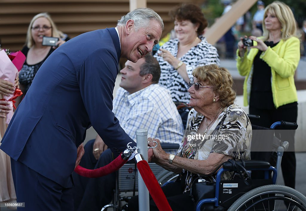 Prince Charles, Prince of Wales shakes hands with a woman in a wheelchair outside the Sydney Opera House on November 9, 2012, in Sydney, Australia. Prince Charles, Prince of Wales and Camilla, Duchess of Cornwall are touring Australia for six days to commemorate the diamond jubilee of his mother Queen Elizabeth's II.