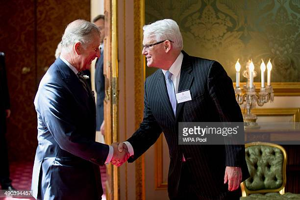 Prince Charles Prince of Wales shakes hands with Canada's High Commissioner to London Gordon Campbell during a reception for Canadians living and...