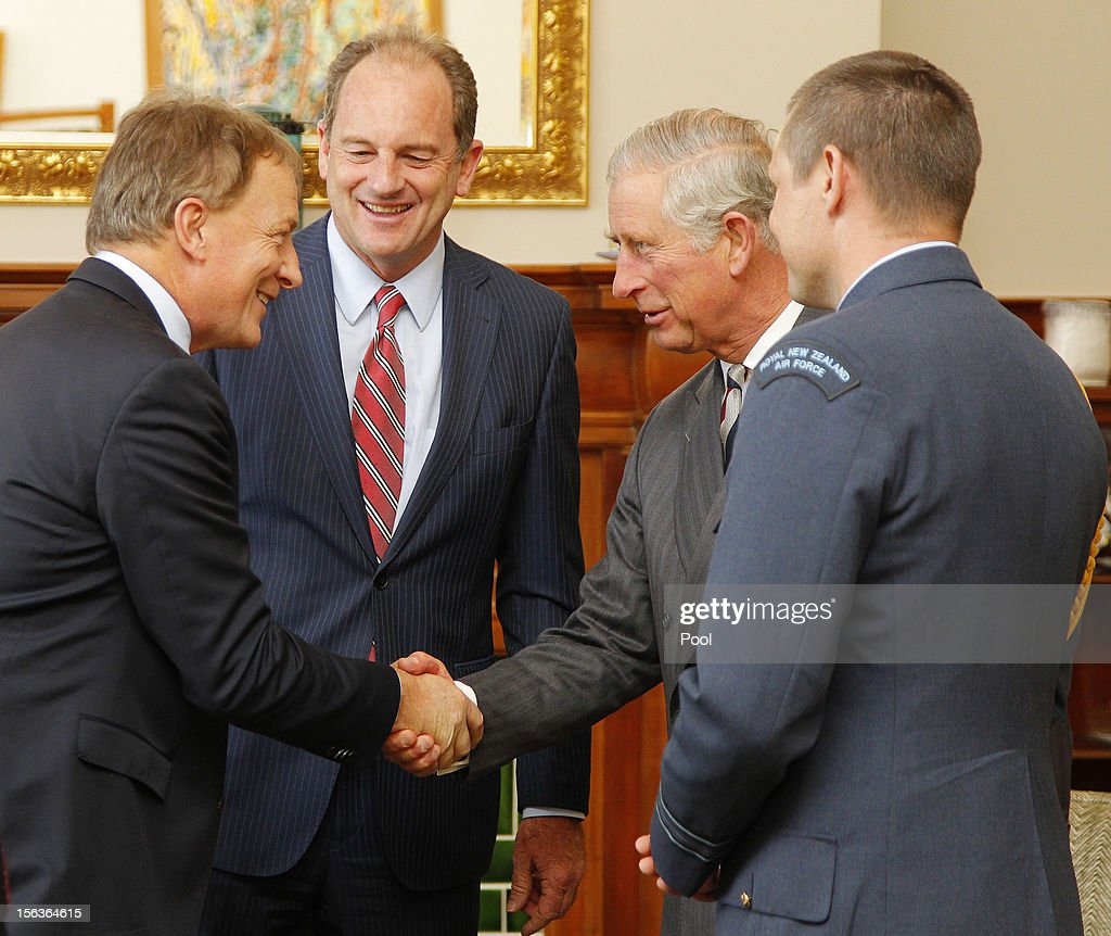 Prince Charles, Prince of Wales shakes hands with former Labour leader Phil Goff as current Labour leader David Shearer (2nd L) smiles at Government House on November 14, 2012 in Wellington, New Zealand. The Royal couple are in New Zealand on the last leg of a Diamond Jubilee that takes in Papua New Guinea, Australia and New Zealand.