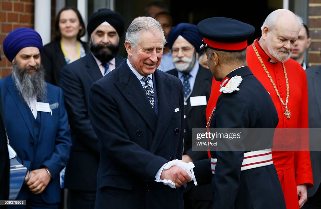 Prince Charles, Prince of Wales shakes hands with Kenneth Olisa, the Lord-Lieutenant of Greater London as he leaves after a visit to St John's Church on February 10, 2016 in Southall, England. The Prince met members of the congregation and heard about the church's inter-faith work and role in the local community.