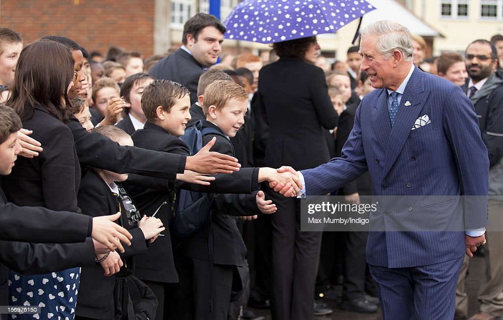 Prince Charles, Prince of Wales shakes hands with pupils as he, accompanied by Jamie Oliver, visits Carshalton Boys Sports College to see how the school has transformed its approach to healthy eating on November 26, 2012 in Carshalton, England.