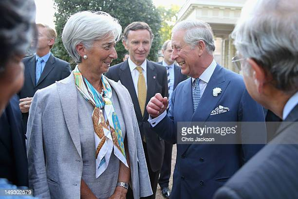 Prince Charles Prince of Wales shares a joke with Head of the IMF Christine Lagarde during a reception for delegates of the Global Investment...