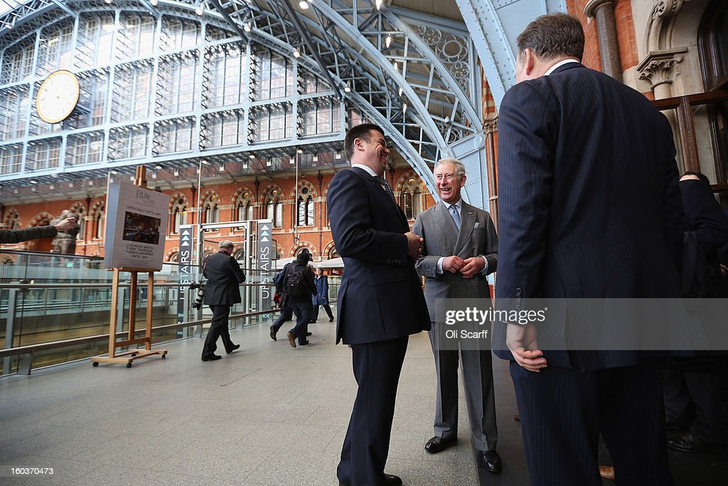 Prince Charles, Prince of Wales shares a joke with Kevin Kelly (C), General Manager of St Pancras Renaissance London Hotel as they admire the architecture of St Pancras International Station during a visit to St Pancras Renaissance London Hotel, adjacent to St Pancras International Station, on January 30, 2013 in London, England. The Prince of Wales and The Duchess of Cornwall are marking the 150th anniversary of London Underground to emphasise the importance of engineering and infrastructure development in the UK.