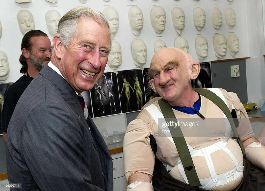 Prince Charles, Prince of Wales shares a laugh with Peter Hambleton, who plays the Dwarf Gloin in the new 'Hobbit' film, at Weta Workshop on November 14, 2012 in Wellington, New Zealand. The Royal couple are in New Zealand on the last leg of a Diamond Jubilee that takes in Papua New Guinea, Australia and New Zealand.