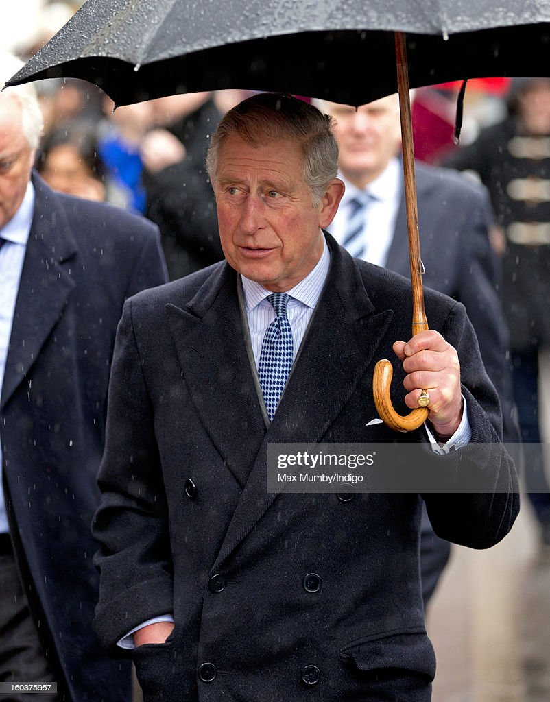 <a gi-track='captionPersonalityLinkClicked' href=/galleries/search?phrase=Prince+Charles&family=editorial&specificpeople=160180 ng-click='$event.stopPropagation()'>Prince Charles</a>, Prince of Wales shelters under an umbrella as he arrives at Farringdon Underground Station to view the nearby Crossrail development site before travelling on a Metropolitan line underground train to King's Cross on January 30, 2013 in London, England. The Prince of Wales and The Duchess of Cornwall are marking the 150th anniversary of London Underground to emphasise the importance of engineering and infrastructure development in the UK.