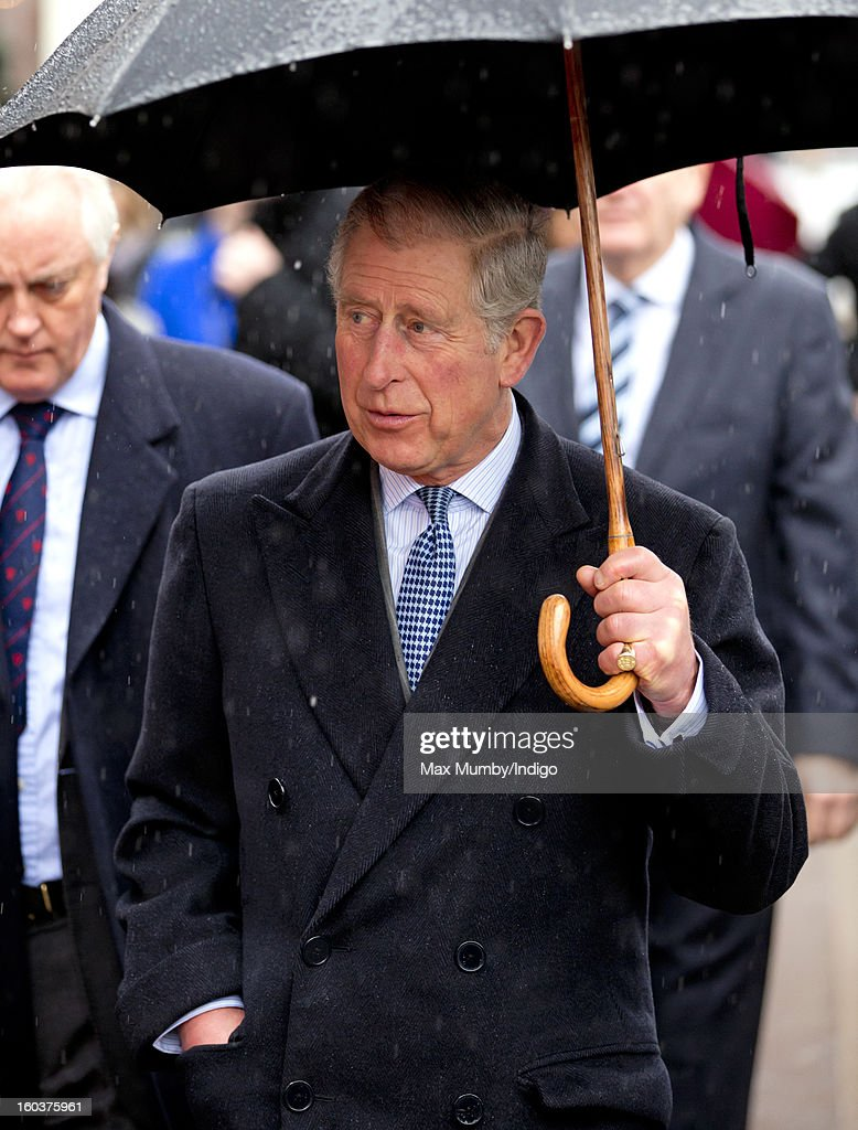 Prince Charles, Prince of Wales shelters under an umbrella as he arrives at Farringdon Underground Station to view the nearby Crossrail development site before travelling on a Metropolitan line underground train to King's Cross on January 30, 2013 in London, England. The Prince of Wales and The Duchess of Cornwall are marking the 150th anniversary of London Underground to emphasise the importance of engineering and infrastructure development in the UK.