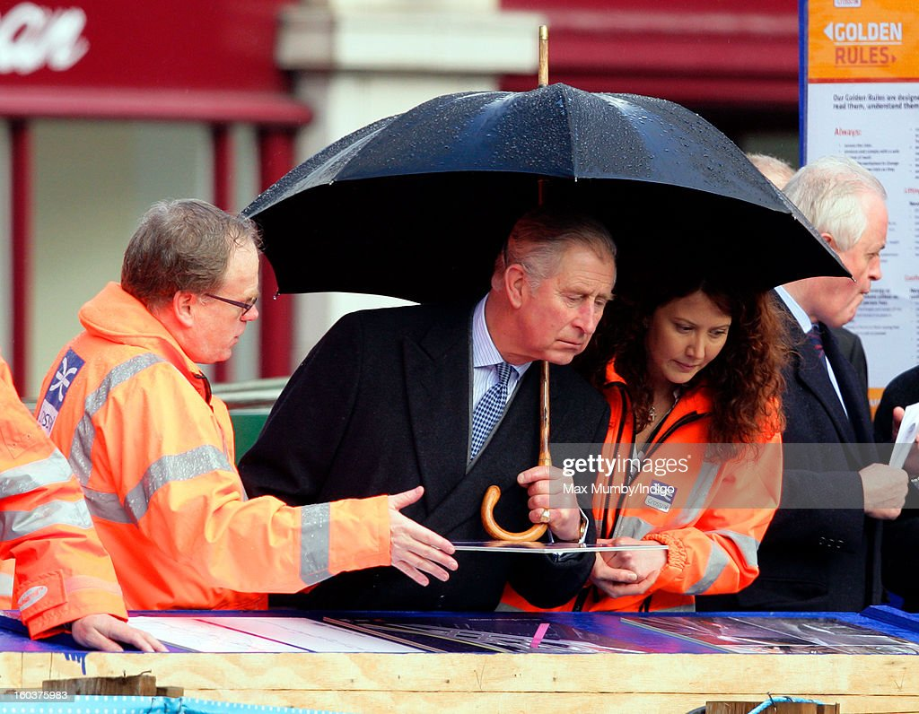 <a gi-track='captionPersonalityLinkClicked' href=/galleries/search?phrase=Prince+Charles&family=editorial&specificpeople=160180 ng-click='$event.stopPropagation()'>Prince Charles</a>, Prince of Wales shelters under an umbrella as he views the Crossrail development site before travelling on a Metropolitan line underground train from Farringdon to King's Cross on January 30, 2013 in London, England. The Prince of Wales and The Duchess of Cornwall are marking the 150th anniversary of London Underground to emphasise the importance of engineering and infrastructure development in the UK.