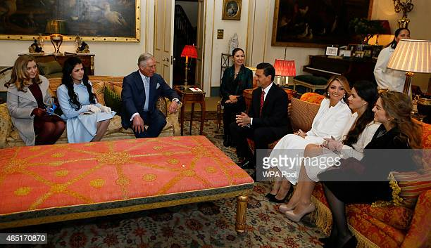 Prince Charles Prince of Wales sits with the President of Mexico Enrique Pena Nieto and first lady Angelica Rivera and their daughters during a visit...