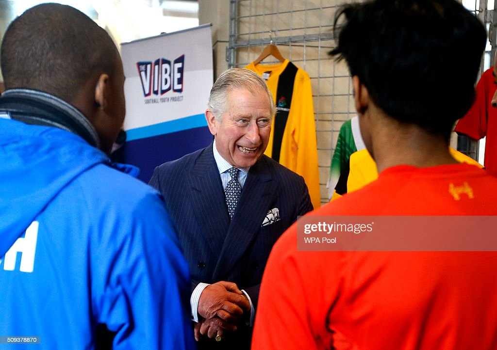 Prince Charles, Prince of Wales smiles as he meets players from the Onside Football Project during a visit to St John's Church on February 10, 2016 in Southall, England. The Prince met members of the congregation and heard about the church's inter-faith work and role in the local community.