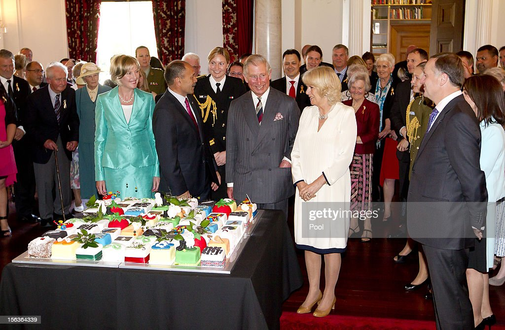 Prince Charles, Prince of Wales smiles as he stands next to his 64th birthday cake with Governor-General of New Zealand Sir Jerry Mateparae, and Camilla, Duchess of Conrwall at Government House on November 14, 2012 in Wellington, New Zealand. The Royal couple are in New Zealand on the last leg of a Diamond Jubilee that takes in Papua New Guinea, Australia and New Zealand.