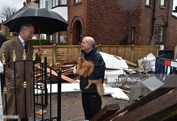 Prince Charles Prince of Wales speaks to flood victim Kieth Wright during a visit to victims of the flooding caused by Storm Desmond in Warwick Road...