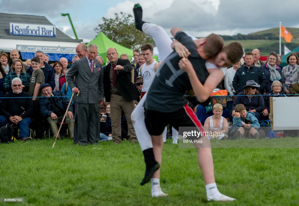 Prince Charles, Prince of Wales speaks to the Kendal Academy Boys Wrestling Club, as they explain the art of Cumbrian Wrestling as he visits The Westmorland County Show on September 14, 2017 in Milnthorpe, England. During his tour of the Westmorland Show Prince Charles presented prizes and toured the many farm animal displays and exhibition marquees.